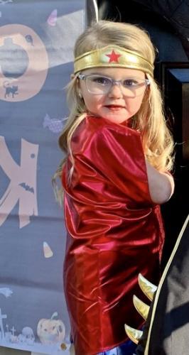 Abby is wearing a Vera Bradley kids frame with prevencia blue blocker lenses