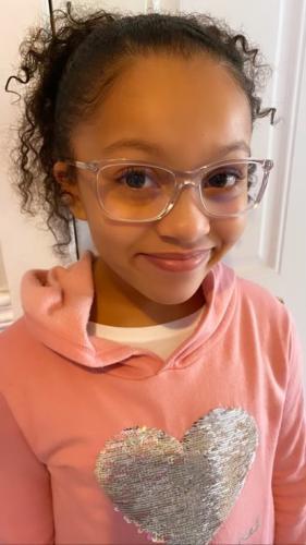 Alana is wearing a Michael Kors frame with  prevencia blue blocker lenses